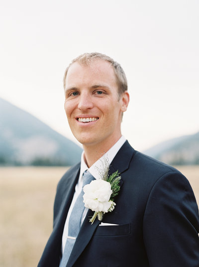 Groom and boutonniere at 320 Ranch Wedding in Big Sky, MT