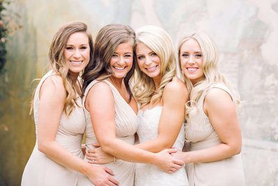 Wedding Photography, bride and bridesmaids standing together for a picture