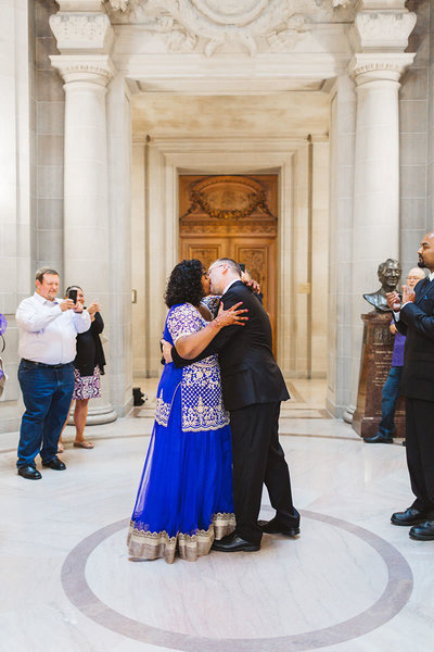 indian bride first kiss in rotunda at san francisco city hall