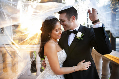 groom and bride under veil at ebell los angeles sunset portrait