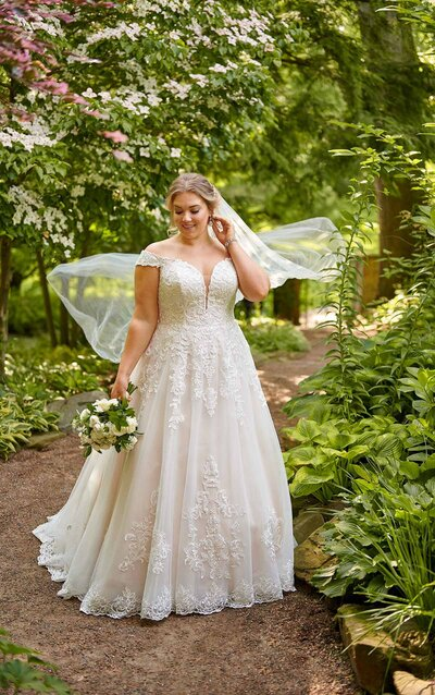 Adara is breathtaking in so many ways, from her amazingly airy skirt to the floral detail work.