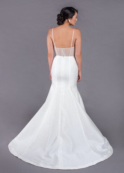 Back view of the Gladys wedding dress with its spaghetti straps and illusion back