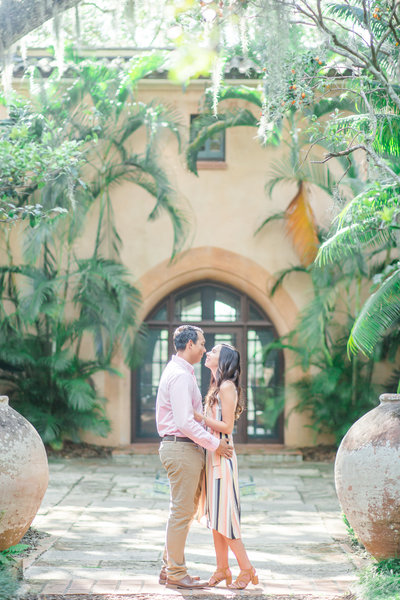 A couple embraces in front of Pinewood Estate at Bok Tower Gardens.