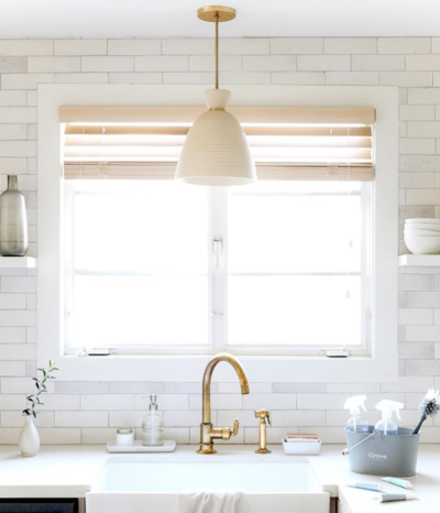 kitchen with white walls and gold faucet