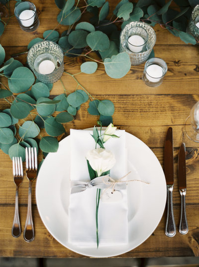 Simple Wedding Place Setting with Greenery at Rainbow Ranch Lodge