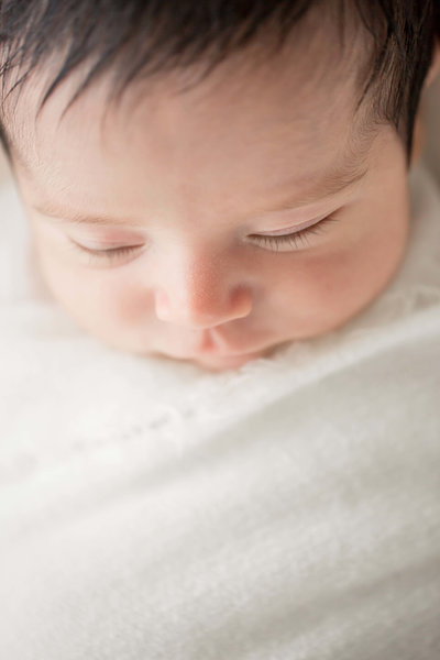 baby boy sleeping for newborn photoshoot