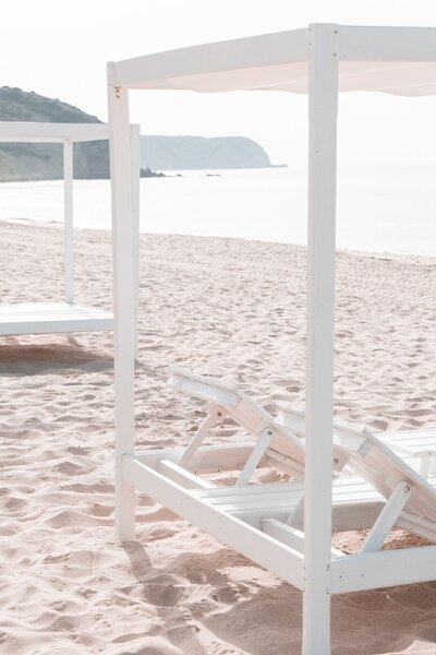 Resort lounge chairs in the sand
