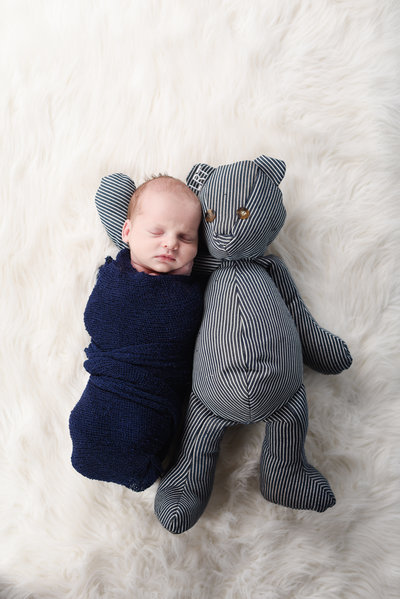 Beautiful Mississippi Newborn Photography:newborn boy wrapped in navy with teddy bear made from grandfather's overalls