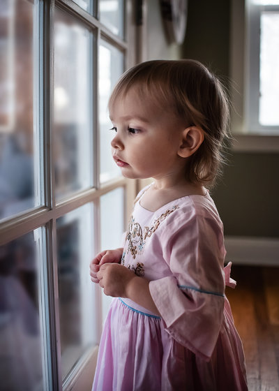 little girl at window. Bucks County Family & newborn photographer