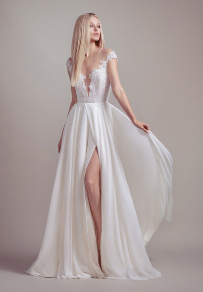Blush by Hayley Paige bridal gown - Ivory lace and chiffon A-line gown, cap sleeve lace bodice with nude lining, deep sweetheart neckline and illusion bateau, open strappy back and chiffon skirt with slit.