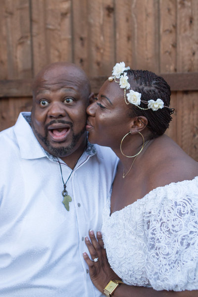 African American Bride Kissing African American Groom on Cheek