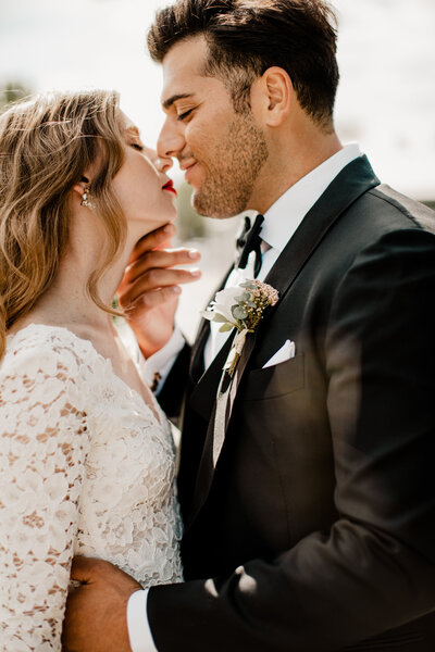 husband and wife kissing on wedding day