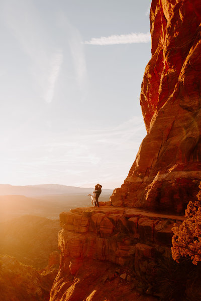 Sunset engagement session at Cathedral Rock in Sedona Arizona by Skyler and Vhan