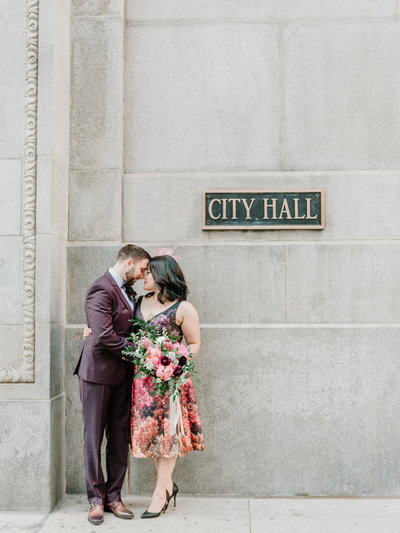 couple standing in front of city hall