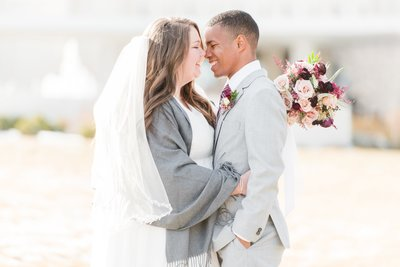 bride and groom in the winter in front of the jordan river temple