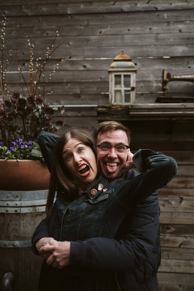 Couple pulling faces in engagement session