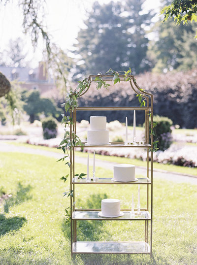 wedding cakes on shelf in garden