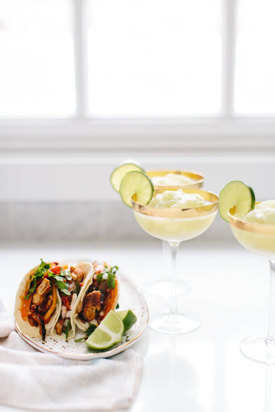 tacos and margaritas on a table