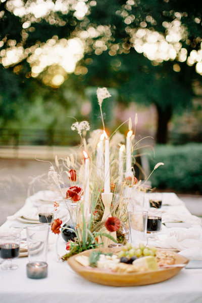 Candlelit fall dinner table mood with foraged flower centerpieces