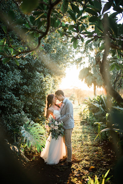 beautiful green sunset shot of wedding couple at Sunset Ranch in Hawaii