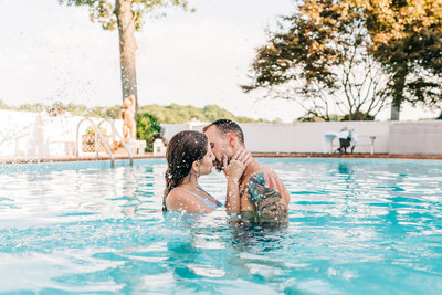 Virginia Wedding Photographer, couple kissing in a pool