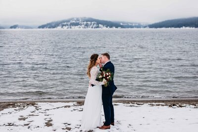 Snow Elopement with Lake and Mountains Winter Wedding Couple in Coeur d'Alene - Clara Jay Photo-2