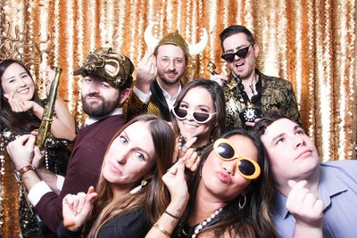 corporate party.l gold theme photo booth friends