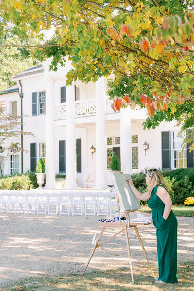 Meghan Elizabeth Photography photographs live wedding painter Brittany Branson at Keswick Vineyards in Charlottesville Virginia