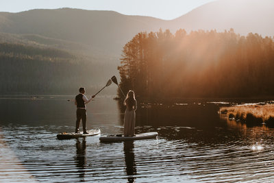 Couple paddleboarding on their wedding day in Grand Lake, Colorado
