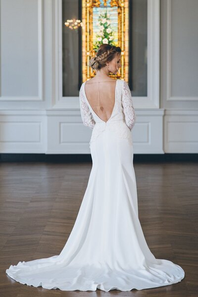Back view of the open back of the Bibi lace and crepe wedding dress from the 2018 Edith Elan bridal collection