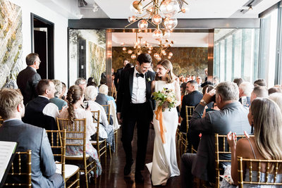 Couple celebrates getting married in the ceremony room at canoe restaurant