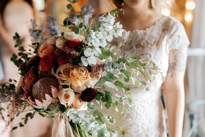 Bride holding her flower bridal bouquet