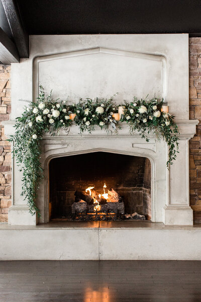 The Lake House Calgary wedding with white flowers and greenery mantel arrangement, Flowers by Janie