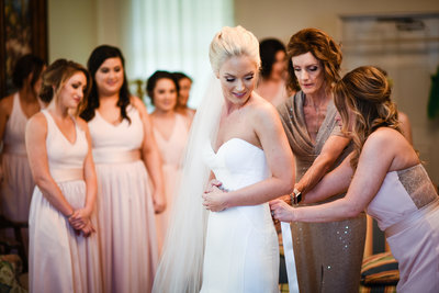 Bridemaids and Mom get Bride dressed at First Presbyterian, Biloxi, MS