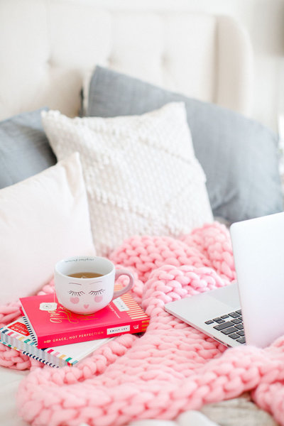 cozy couch with blanket and laptop