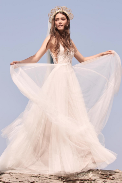 Delena is perfectly fitted from all angles, with romantic details that never end. Cascading buttons down the back with delicate scalloped lace, and a frothy a-line skirt makes this gown one you will never want to take off.