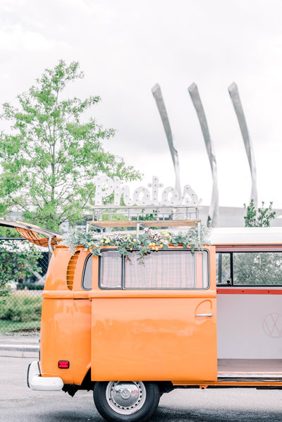 Retro camper photobooth decorated with wedding florals