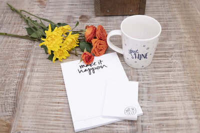 Bouquet of flowers with mug and pad of paper