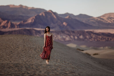 woman standing in desert