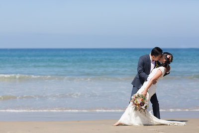 Bride and Groom dipping on the beach at La Jolla Shores Hotel