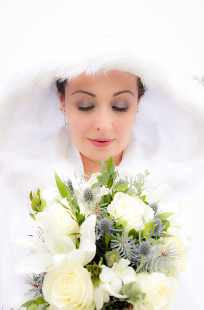 Beautiful Toronto Wedding bride with flowers. This gorgeous bride takes a moment with her yellow and white flowers. Her white shawl fits in with the winter theme of the wedding in Toronto, and snow sure was coming down that way.