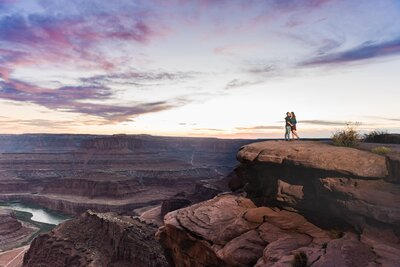 Engaged couple at Dead Horse Point at sunset