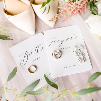 A bride's wedding details - vow books, rings, shoes, and flowers from her wedding at A'BULAE in St. Paul, Minnesota