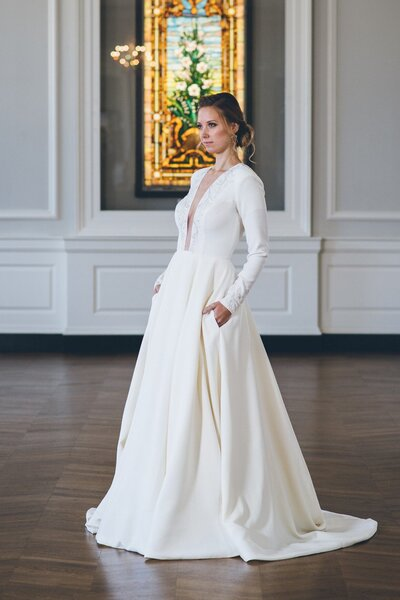 Model wears the Iman ballgown wedding dress with long sleeves