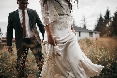 athena-and-camron-intimate-woodlands-bohemian-wedding-rain-kandice-federico-silk-bhldn-dress-walk