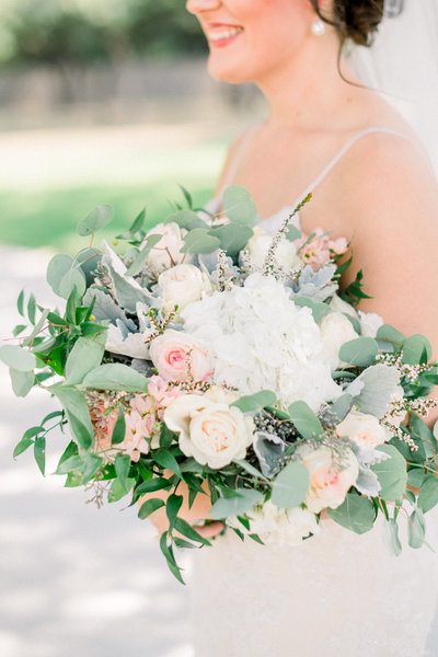 ivory, green and pink pastel colored floral boquet carried by a bride by atlanta wedding photographer lane albers photography