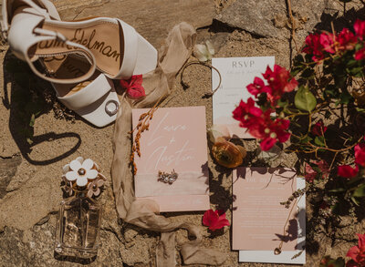 photo of bride accessories laying on stone