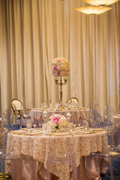 Beauty and the Beast Wedding at Opal Sands. clearwater wedding venue. Clearwater wedding planners. clearwater wedding photographers. blush and gold wedding. beauty and the beast. blush linens. gold chargers. ghost chairs.