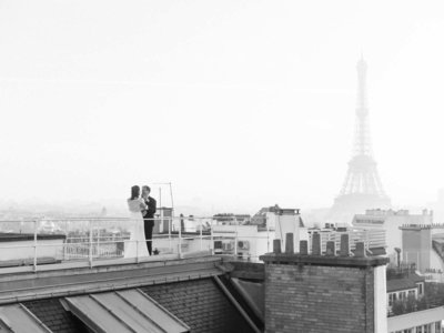 bride and groom portraits on the rooftop at their four seasons wedding at the george V in Paris