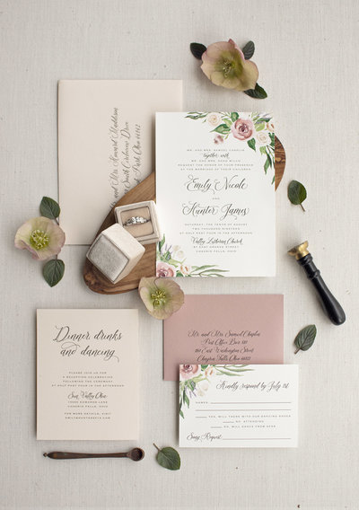 An elegant floral wedding invitation featuring hand-painted watercolor roses, lavender and beautiful flowing greenery. Showing 4 piece suite.